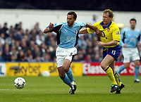 Photo. Chris Ratcliffe<br /> Fulham v Arsenal. FA Premiership. 09/05/2004<br /> Sylvain Legwinski and Ray Parlour tussle for the ball