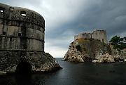 Fortress Bokar (left)  and Fortress Lovrijenac (Fort of Saint Lawrence), guarding the entrance to Dubrovnik's oldest harbour, Kalarinja. Dubrovnik old town, Croatia
