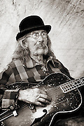 Mad Jack and his guitar at a Mountain Man Rendezvous in West Yellowstone, Montana.