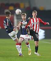 Brentford's Marcus Forss challenges Middlesbrough's Hayden Coulson and Hayden Hackney<br /> <br /> Photographer Rob Newell/CameraSport<br /> <br /> The Emirates FA Cup Third Round - Brentford v Middlesbrough - Saturday 9th January 2021 - Brentford Community Stadium - Brentford<br />  <br /> World Copyright © 2021 CameraSport. All rights reserved. 43 Linden Ave. Countesthorpe. Leicester. England. LE8 5PG - Tel: +44 (0) 116 277 4147 - admin@camerasport.com - www.camerasport.com