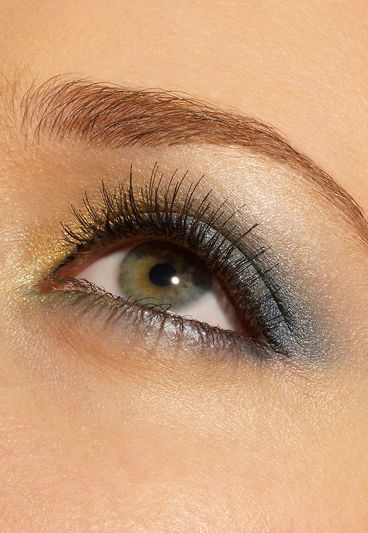Close up photo of woman's beautiful eye with lovely make up and lashes
