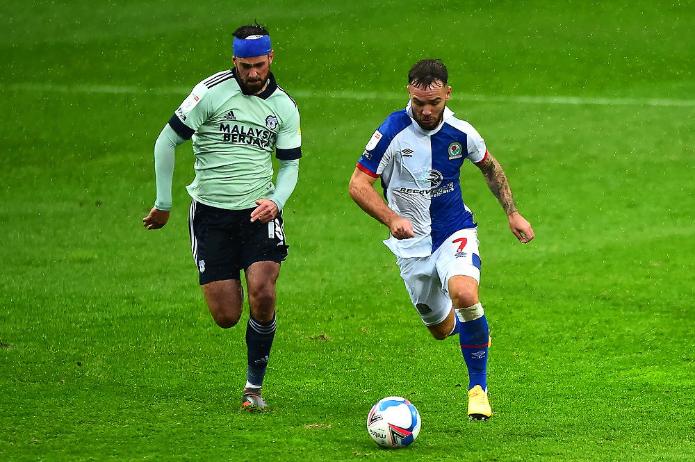 Blackburn Rovers' Adam Armstrong is pursued by Cardiff City's Greg Cunningham<br /> <br /> Photographer Richard Martin-Roberts/CameraSport<br /> <br /> The EFL Sky Bet Championship - Blackburn Rovers v Cardiff City - Saturday 3rd October 2020 - Ewood Park - Blackburn<br /> <br /> World Copyright © 2020 CameraSport. All rights reserved. 43 Linden Ave. Countesthorpe. Leicester. England. LE8 5PG - Tel: +44 (0) 116 277 4147 - admin@camerasport.com - www.camerasport.com