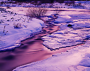 Ice-covered Lee Vining Creek flowing toward Mono Lake at dusk with pinkish-violet light, Mono Lake Tufa State Reserve and Mono Basin National Forest Scenic Area, Inyo National Forest, California.
