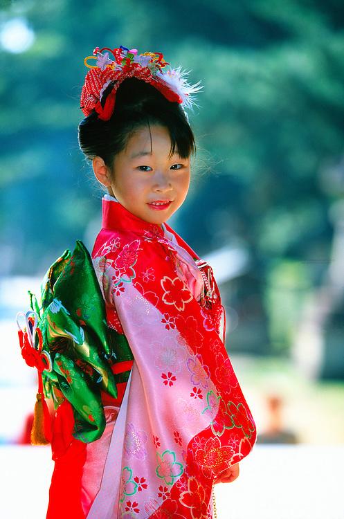 7 year old girl wearing kimono (Seven-five-three festival), Kitano-Tenmangu Shrine, Kyoto, Japan