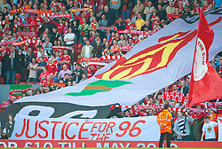 11.04.2010, Anfield, Liverpool, ENG, Premier League, FC Liverpool vs FC Fulham, im Bild Liverpool's supporters on the Spion Kop display banners to mark the 21st anniversary of the Hillsborough Stadium Disaster of the 15th April 1989, in which 96 Liverpool supporters lost their lives, before the Premiership match against Fulham at Anfield, the nearest game to the anniversary. EXPA Pictures © 2010, PhotoCredit: EXPA/ Propaganda/ D. Rawcliffe / SPORTIDA PHOTO AGENCY