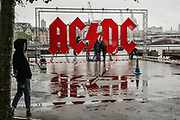 Workers assemble an AC/DC panel in Southbank, central London on Friday, Oct 2, 2020 - as the heavy rain batters the capital. Forecasters warn Southern coastal areas of England could see gusts of up to 65mph and others could be at risk of flooding before the end of the weekend, as the French storm arriving on Friday is expected to be followed by another band of cold and blowy conditions. (VXP Photo/ Sabrina Merolla)