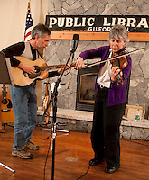 """Fiddler Ellen Carlson accompanied by Tim Mowry on guitar entertains at Gilford Library with a blues song """"Sitting on Top of the World"""" followed by jazz, bluegrass and irish selections Thursday evening.    (Karen Bobotas/for the Laconia Daily Sun)"""