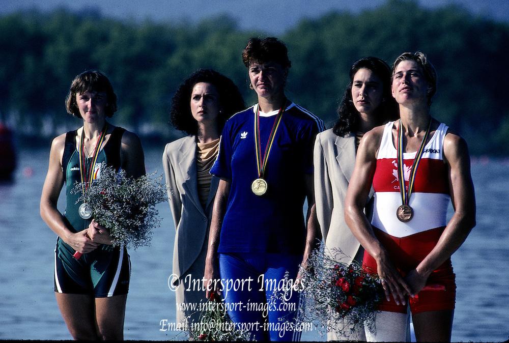 Barcelona Olympics 1992 - Lake Banyoles, SPAIN, ROM, W1X Medals Gold, LIPA, Elisabeta, BEL,  W1X, Silver BREDAEL, Annelies, CAN W1X Bronze, LAUMANN, Silken Suzette.  Photo: Peter Spurrier/Intersport Images.  Mob +44 7973 819 551/email images@intersport-images.com.       {Mandatory Credit: © Peter Spurrier/Intersport Images].