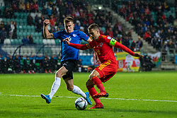 TALLINN, ESTONIA - Monday, October 11, 2021: Wales' captain Aaron Ramsey (R) and Estonia's Mattias Käit during the FIFA World Cup Qatar 2022 Qualifying Group E match between Estonia and Wales at the A. Le Coq Arena. Wales won 1-0. (Pic by David Rawcliffe/Propaganda)
