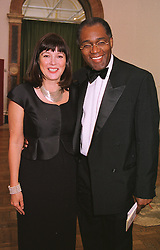 MISS BELINDA HARLEY and broadcaster MR TREVOR PHILLIPS, at a dinner in London on 1st June 1999.MSR 73A
