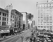 ackroyd-P471-28 Orpheum theater & Meier & Frank parking lot, pedestrians crossing street at 6th & Morrison, February 6, 1969.  (Orpheum was on SW Broadway between Morrison and Yamhill, now the site of Nordstroms.)