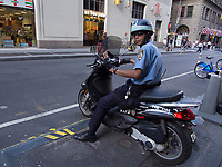 NYPD police officer on a motor scooter near Wall street in New York City.