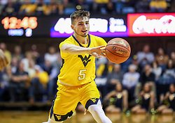 Mar 20, 2019; Morgantown, WV, USA; West Virginia Mountaineers guard Jordan McCabe (5) passes the ball during the second half against the Grand Canyon Antelopes at WVU Coliseum. Mandatory Credit: Ben Queen