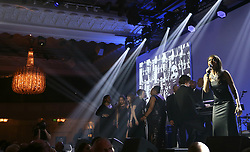 A choir sings in tribute to Cyrille Regis during the 2018 PFA Awards at the Grosvenor House Hotel, London. PRESS ASSOCIATION Photo. Picture date: Sunday April 22, 2018. See PA story SOCCER PFA. Photo credit should read: Steven Paston/PA Wire