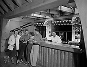 "Y-501108-06. Ramshead Bar in Timberline Lodge, Mt. Hood. November 8, 1950 caption published in Oregonian November 12, 1950: ""High Life. Most of the social life at Timberline centers around the Ramshead bar on the mezzanine around the mammoth fireplace, with the mountain for a backdrop"""