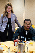 UConn President Susan Herbst talks with Omar Calhoun and other members of the mens basketball team during a team lunch at the Hyatt Regency in Dallas, Texas before watching her school compete in the NCAA Final Four on April 5, 2014. (Cooper Neill / for The New York Times)