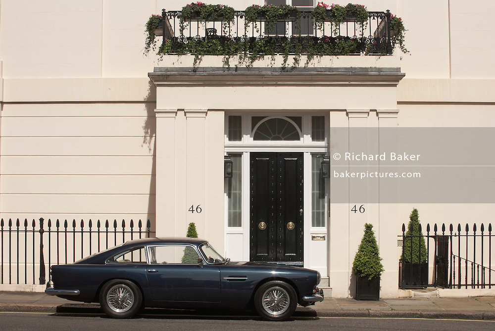 Classic Aston Martin DB5 is parked outside the exclusive number 46, Chester Square SW1 in London's Belgravia.