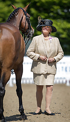© Licensed to London News Pictures. 10/05/2017. Windsor, UK. Confirmation judge Miss M L Hennessy inspects a horse in the Small Hunter competition category on the first day of the Royal Windsor Horse Show. The five day equestrian event takes place in the grounds of Windsor Castle. Photo credit: Peter Macdiarmid/LNP