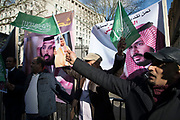 Protesters demonstrate on Whitehall in favour of Saudi Crown Prince Mohammad Bin Salman official visit to the UK on 7th March 2018 in London, United Kingdom. Mohammad bin Salman started his visit to the UK with the Conservative Party and royal family rolling out the red carpet for Saudi Arabias crown prince as opposition politicians and rights groups call on the British Prime Minister to use the trip to challenge the kingdoms record on human rights. Campaigners accuse Mohammad bin Salman of being the 'chief architect' of the Yemen war, which has led to what the U.N.  describes as the worlds worst humanitarian crisis.
