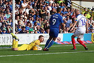 Portsmouth goalkeeper Craig MacGillivray (15) saving the ball during the EFL Sky Bet League 1 match between AFC Wimbledon and Portsmouth at the Cherry Red Records Stadium, Kingston, England on 13 October 2018.