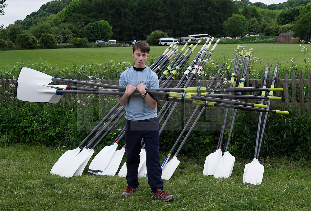 © Licensed to London News Pictures.13/06/15<br /> Durham, England<br /> <br /> A young rower carries oars as he prepares for his race during the 182nd Durham Regatta rowing event held on the River Wear. The origins of the regatta date back  to commemorations marking victory at the Battle of Waterloo in 1815. This is the second oldest event of this type in the country and attracts over 2000 competitors from across the country.<br /> <br /> Photo credit : Ian Forsyth/LNP