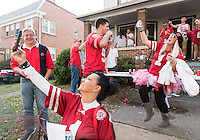 Kim Westerkamp, below, takes a picture while visiting a party with niece Cootie Leeberg, right, in No. 1 jersey, before the Nebraska Cornhuskers played the Wisconsin Badgers in a football game at Camp Randall Stadium in Madison, Wisconsin, on Saturday, Oct. 29, 2016. <br /> <br /> MATT DIXON/THE WORLD-HERALD