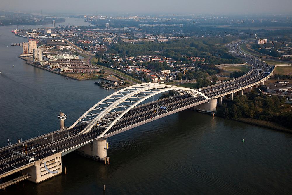 Nederland, Zuid-Holland, Rotterdam 19-09-2009; Rotterdam-Zuid, deelgemeente Feijenoord / IJsselmonde, Van Brienenoordbrug, boogbrug over de Nieuwe Maas..Autoweg A16 gezien naar het Zuidoosten (richting Ridderkerk), links van / achter de brug flats en eengezinswoningen in Oud-IJsselmonde en Beverwaard. Air view on the river Meuse of Rotterdam Bottom the double bridge (Van Brienenoord) of the motorway A16, connecting the north and the south bank of the river. Main artery to the south.luchtfoto (toeslag), aerial photo (additional fee required).foto/photo Siebe Swart