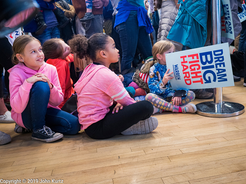 04 NOVEMBER 2019 - GRINNELL, IOWA: A group of children listen to US Senator Elizabeth Warren at Grinnell College. Sen. Warren spoke to a crowd of about 850 students and local residents. She brought her campaign to be the Democratic nominee for the US Presidency to the college town of Grinnell, Iowa, Monday. Iowa holds the first selection event of the 2020 presidential election cycle. The Iowa caucuses are Feb. 3, 2020..           PHOTO BY JACK KURTZ