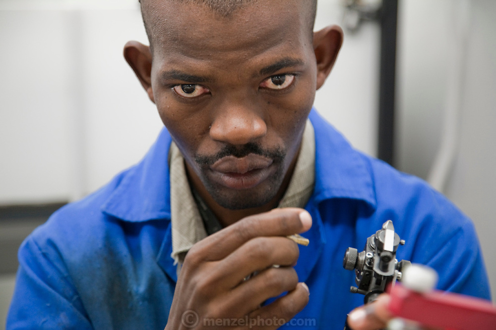 A diamond polisher examines a gem in a polishing factory at NamCot Diamonds in Windhoek, Namibia. Diamonds are one of Namibia's major exports, and  while conflict diamonds grab the headlines, the fact is that the industry does provide a fairly decent living for many.