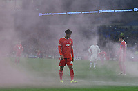 Football - 2018 / 2019 UEFA Nations League B - Group Four: Wales vs. Denmark<br /> <br /> Tyler Roberts of Wales in smoke from a flare thrown onto the pitch , at Cardiff City Stadium.<br /> <br /> COLORSPORT/WINSTON BYNORTH