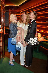 Left to right, CAMILLE SEYDOUX, ALEXIA NIEDZIELSKI and ARIZONA MUSE at a dinner hosted by Roger Vivier to celebrate The Prismick Denim by Camillle Seydoux held at Casa Cruz, 123 Clarendon Road, London on 17th March 2016.