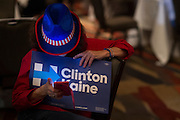 """A guest holds her """"Clinton Kaine"""" poster during the Dallas County Democratic watch party in Dallas, Texas on November 8, 2016. (Cooper Neill for The Texas Tribune)"""