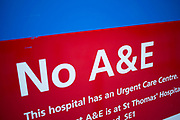 Sign at a hospital reads No A&E. This is a sign that Accident and Emergency departments in teh UK NHS are closing. Some remain open as this sign explains, but many National Health Service hospitals have had to close these departments as cuts to public services bite hard during the recession. London, UK.