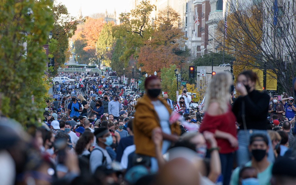 Crowds stretch from Lafayette Square to Scott Cir, in Washington DC. People from Baltimore-Washington Area gather around the White House to celebrate the announcement of Joe Biden's election as the Next President of the United States.