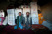 Doing business, an Afghan Kyrgyz with a Badakshi trader. In Sarhad village, inhabited by Wakhis people. It is the end of the jeepable road in the Wakhan corridor, and the beginning of the trek up to the Little Pamir where the Afghan Kyrgyz live.