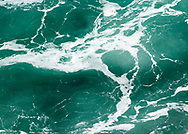 """Abstract of aqua blue ocean waves   Each 252-piece photo puzzle comes in a sturdy, finished cardboard box and measures 10"""" x 14"""" when complete"""