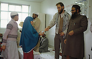 United Kingdom. Birmingham. Mustahim Bleher is a German who converted to Islam.  He is also Secretary of the Islamic party created in May 1989. In charge of educational problems, he often visits the Islamic schools of the country.  Here we see the giving of the end of the year prize at an Islamic school in England (U.K. Islamic Mission).  Birmingham  United†Kingdom     /  Mustapha Bleher est un allemand converti a líisalm, il est membre du parti islamique. distribution des prix a líU.K. Islamic Mission  Birmingham  Grande Bretagne