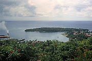 Coastal landscape view over ship in port and Navy Island at Port Antonio, Jamaica, 1970
