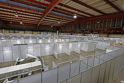 JOHANNESBURG, SOUTH AFRICA - APRIL 25: A general view of assembly at the Nasrec quarantine site currently under construction. With isolation units, consultation areas, ICU capabilitiies, medical facilities, power points, drainage and ablutions the quarantine site has a total bed capacity of 2300 on April 25, 2020 in Johannesburg South Africa. Under pressure from a global pandemic. President Ramaphosa declared a 21 day national lockdown extended by another two weeks, mobilising goverment structures accross the nation to combat the rapidly spreading COVID-19 virus - the lockdown requires businesses to close and the public to stay at home during this period, unless part of approved essential services. (Photo by Dino Lloyd)