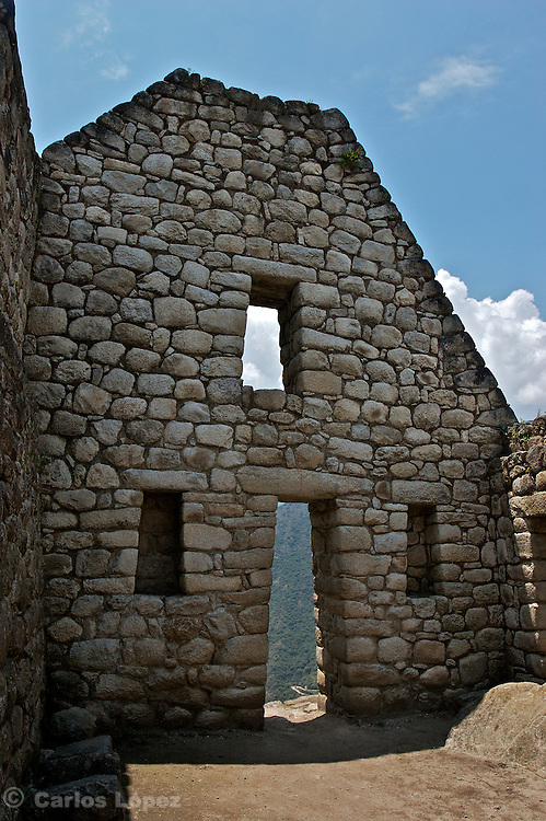 One wall in the ruins of Machu Picchu, the lost city of the Inca empire, located in the region of Cusco in Peru. Now one of the new seven wonder of the modern world,