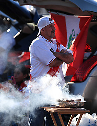 March 23, 2018 - Miami Gardens, Florida, USA - Peruvian fans enjoy a barbecue outside of the stadium before the FIFA 2018 World Cup preparation match between the Peru National Soccer Team and the Croatia National Soccer Team at the Hard Rock Stadium in Miami Gardens, Florida. (Credit Image: © Mario Houben via ZUMA Wire)