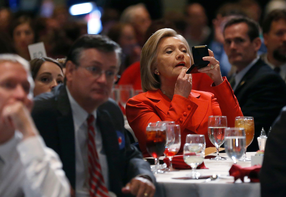 U.S. Democratic presidential candidate Hillary Clinton adjusts her make-up before speaking at the Iowa Democratic Party's Hall of Fame dinner in Cedar Rapids, Iowa, United States, July 17, 2015.   REUTERS/Jim Young