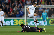 Ashley Williams of Everton tackles Fernando Llorente of Swansea city (c).Premier league match, Swansea city v Everton at the Liberty Stadium in Swansea, South Wales on Saturday 6th May 2017.<br /> pic by  Andrew Orchard, Andrew Orchard sports photography.