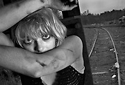 Anya Russian, 22, along the railroad track in Carrboro, North Carolina. iwnwa Railroad