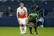 13 December 2015: Referee Chris Penso marks off the spot for the ball as Clemson's T.J. Casner (10) waits. The Clemson University Tigers played the Stanford University Cardinal at Sporting Park in Kansas City, Kansas in the 2015 NCAA Division I Men's College Cup championship match. Stanford won the game 4-0.
