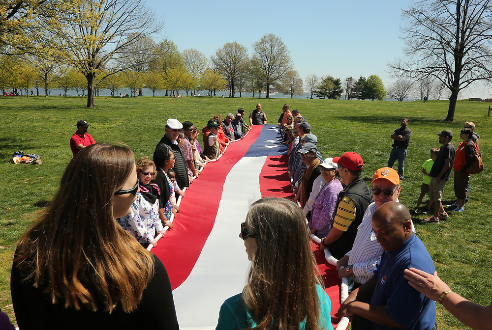 Visitors participating in National Park Service flag ceremony at Fort McHenry National Monument and Historic Shrine.