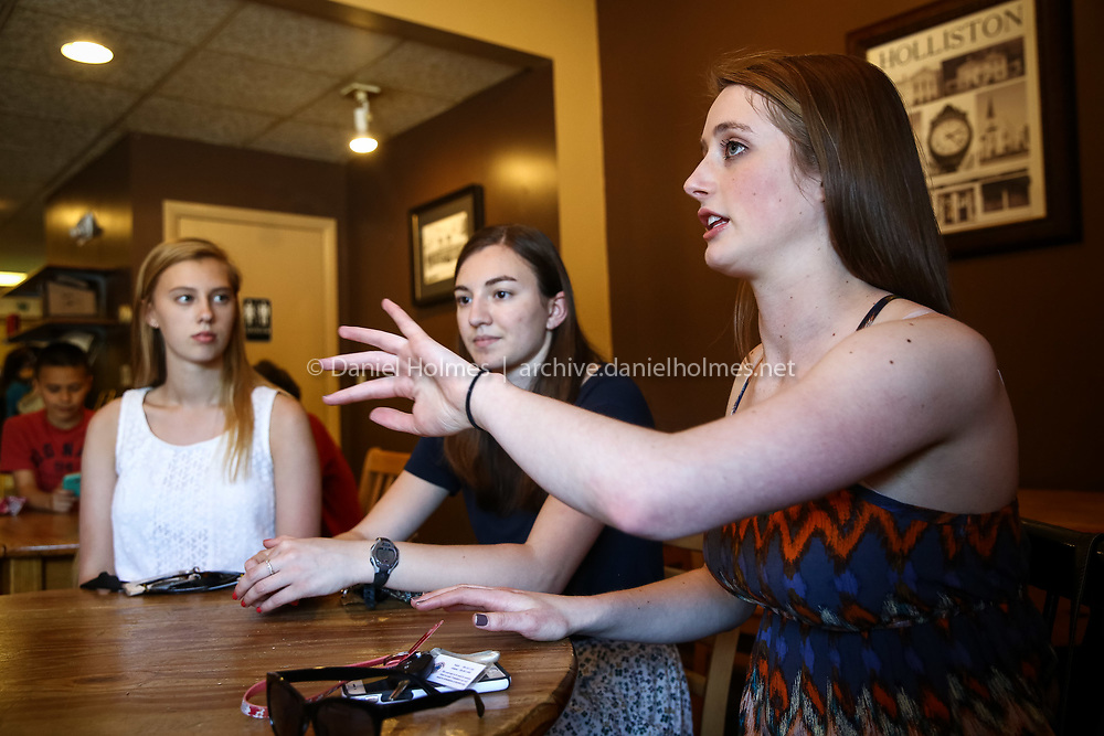 (5/23/16, HOLLISTON, MA) From right to left, Holliston High students Anna Cunningham, Emily Quinan, and Julia Dykema discuss a get the vote out effort for the upcoming town election at Coffee Haven in Holliston on Monday. Daily News and Wicked Local Photo/Dan Holmes