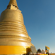 Worshippers walking past stupa at Wat Saket, Bangkok