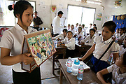 Out-reach peer-peer education to school children. Here Ny Sreay Leak, 16 goes through the LAC produced flip chart of petty crimes and social issues and talk them over with the children. Legal Aid Cambodia  tries through out-reach education in schools to prevent children from falling into crime and teach them their rights. LAC also offer legal aid to children arrested and sent to prison, many of them without any legal representation.