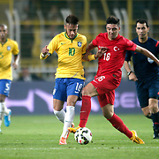 Turkey's Ozan Tufan (R) and Brazil's Neymar JR (L) during their a international friendly soccer match Turkey betwen Brazil at Sukru Saracoglu Arena in istanbul November 12, 2014. Photo by Aykut AKICI/TURKPIX